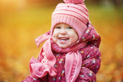 Happy baby girl child outdoors in the park in autumn Royalty Free Stock Image