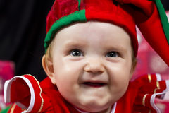 Happy baby girl in Christmas outfit Royalty Free Stock Photos