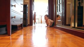 Happy baby girl crawling at floor home stock footage
