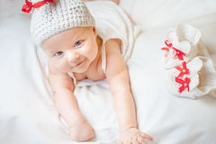 Happy baby girl dressed in knitted bunny costume Royalty Free Stock Image