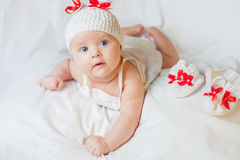 Happy baby girl dressed in knitted bunny costume Royalty Free Stock Photography