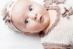 Happy baby girl dressed in knitted pretty costume Royalty Free Stock Images