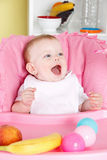 Happy baby girl eating Stock Photo