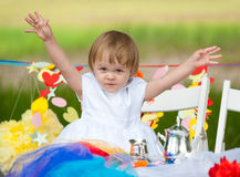 Happy baby girl at festive table Stock Images