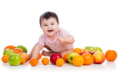 Happy baby girl with fruits Royalty Free Stock Photo