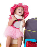 Happy baby girl with glasses, hat and suitcase Royalty Free Stock Photos