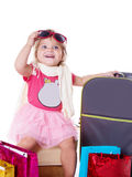 Happy baby girl with glasses and suitcase Stock Images