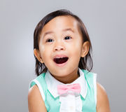 Happy baby girl. With gray background Royalty Free Stock Images