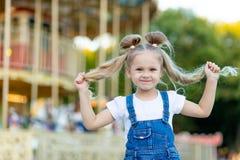 Happy baby girl having fun at an amusement Park, happy childhood
