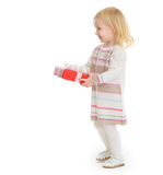 Happy baby girl holding Christmas present box Stock Image