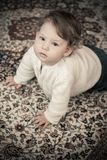 Happy Baby Girl at Home Crawling Stock Photo