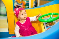 Happy baby girl  keep on board ship on playground Royalty Free Stock Photos