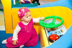 Happy baby girl keep on board ship on playground Royalty Free Stock Photography