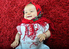 Happy baby girl with kerchief smile Royalty Free Stock Photography