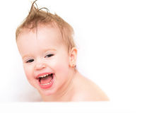 Happy baby girl laughing and bathed in bath Stock Images