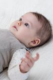 Happy baby girl lying on back Stock Photos