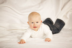 Happy baby girl lying on a couch Royalty Free Stock Image