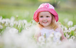 Happy baby girl on meadow with white flowers on the nature Royalty Free Stock Images