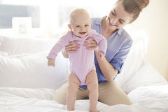 Happy baby girl with mom Stock Image