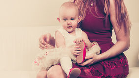Happy baby girl on mother knees. Stock Images