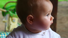 Happy baby girl in nature stock video