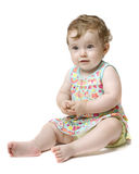 Happy baby girl over white background. Happy baby girl sitting over white background Royalty Free Stock Images