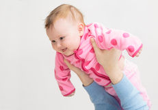 Happy baby girl in parent hands Royalty Free Stock Photography