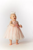 Happy Baby Girl in Party Dress and Hat Royalty Free Stock Photography