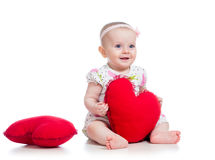 Baby girl with pillow in heart shape Stock Photography