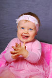 Happy baby girl in pink dress Royalty Free Stock Image