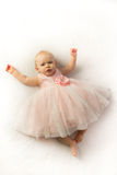 Happy Baby Girl in Pink Frilly Party Dress Stock Images