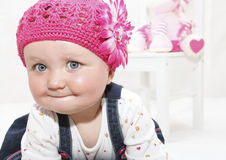 Happy baby girl in pink hat stock images