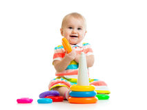 Happy baby girl playing with colorful toy Stock Photography