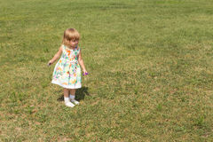 Happy baby girl playing outdoors. Concept of wealth and prosperity Royalty Free Stock Photography