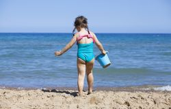 Toddler with bucket at the beach royalty free stock images