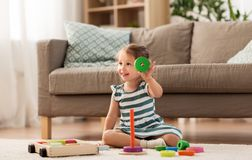 Happy baby girl playing with toy blocks at home stock images