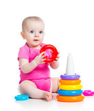 Happy baby girl playing toy. On white Stock Image