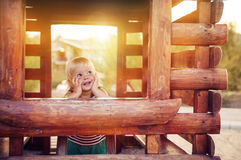 Happy baby girl playing in wooden house Stock Photo