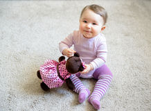 Happy baby girl plays with toy bear Royalty Free Stock Photography