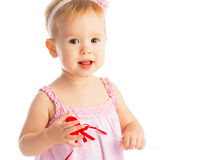 Happy baby girl with red heart isolated Stock Photos