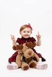 Happy baby girl with reindeer christmas toy Stock Images
