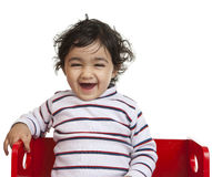 Happy Baby Girl Sitting on a Bench Royalty Free Stock Photography