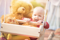 Happy baby girl in swing Stock Images