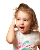 Happy baby girl talking on mobile. Phone isolated on white background Stock Image