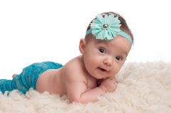 Happy Baby Girl with Turquoise Blue Flower Headband Royalty Free Stock Image