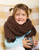 Happy baby girl in warm scarf Stock Image