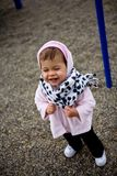 Happy baby girl wearing winter coar and scarf Royalty Free Stock Images