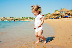 Happy baby going to swim in the sea. Stock Photography