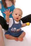 Happy baby with golf ball stock images