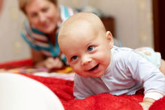 Happy baby with grandmother Stock Image